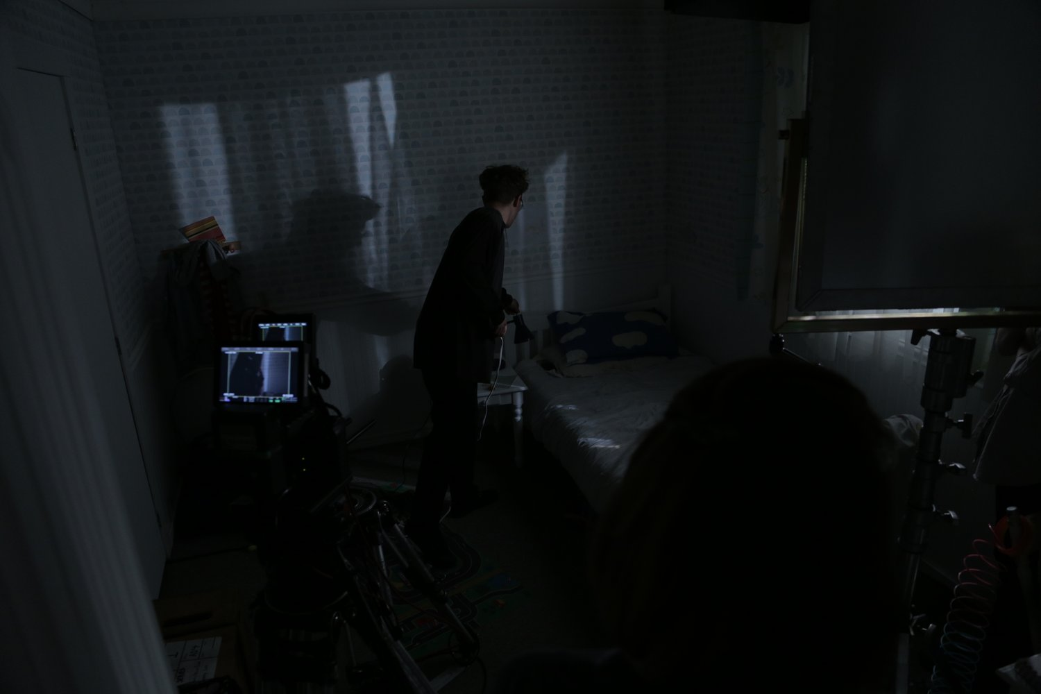 Cinematographer Jeremy Cox setting up for a nighttime shot.