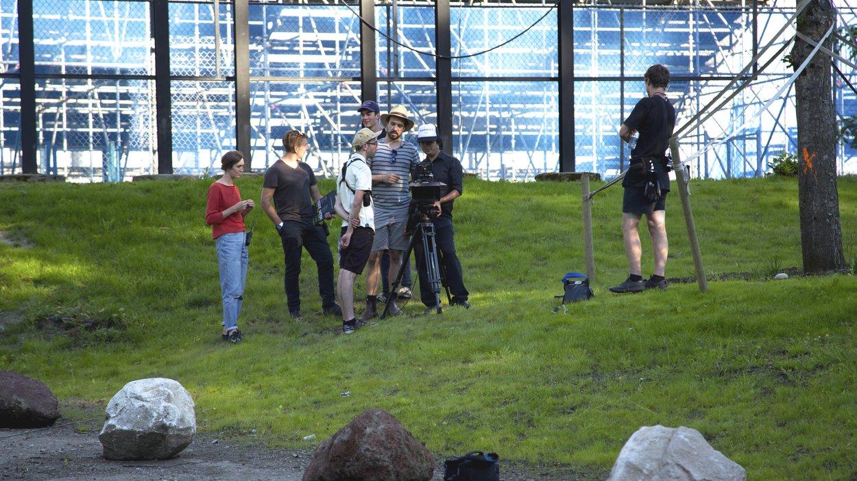 The Boldly team gathers around DP Cedric Yu to dec the Cyclist scene.