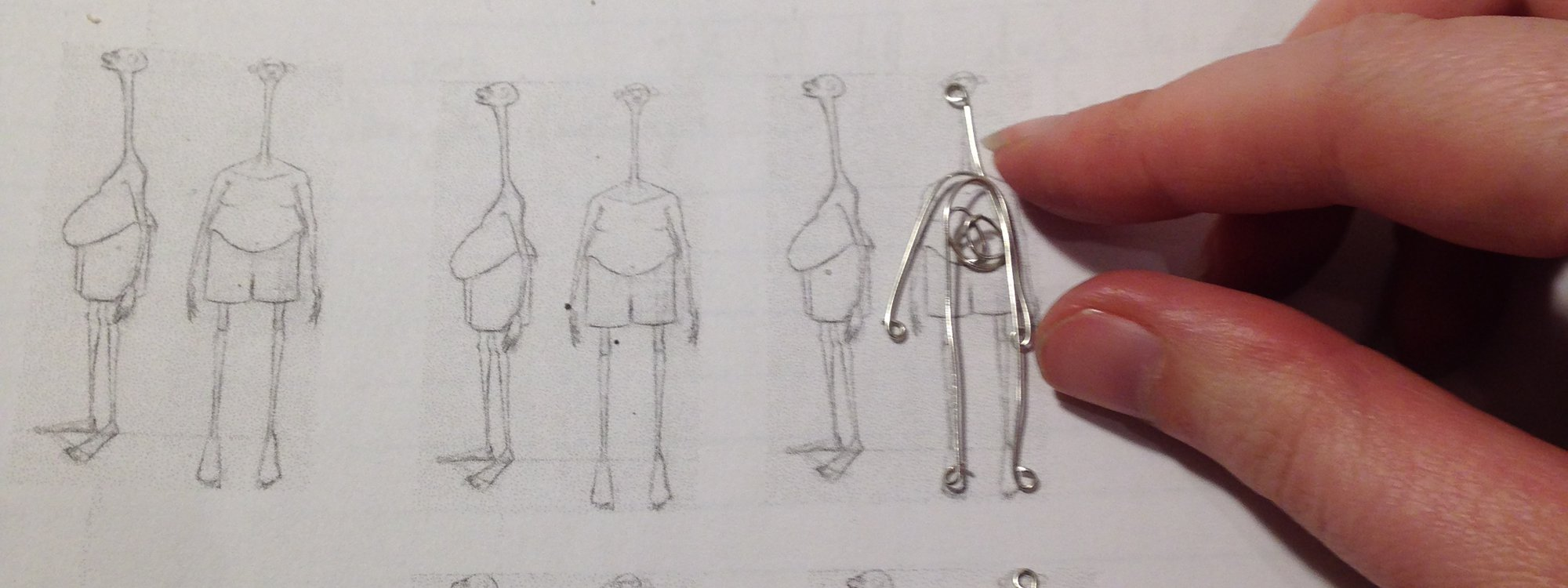 BTS view of the scale model chart used to design and animate the main character.  Each character has dozens of poses, each of which require specific wiring to bring their look to life.